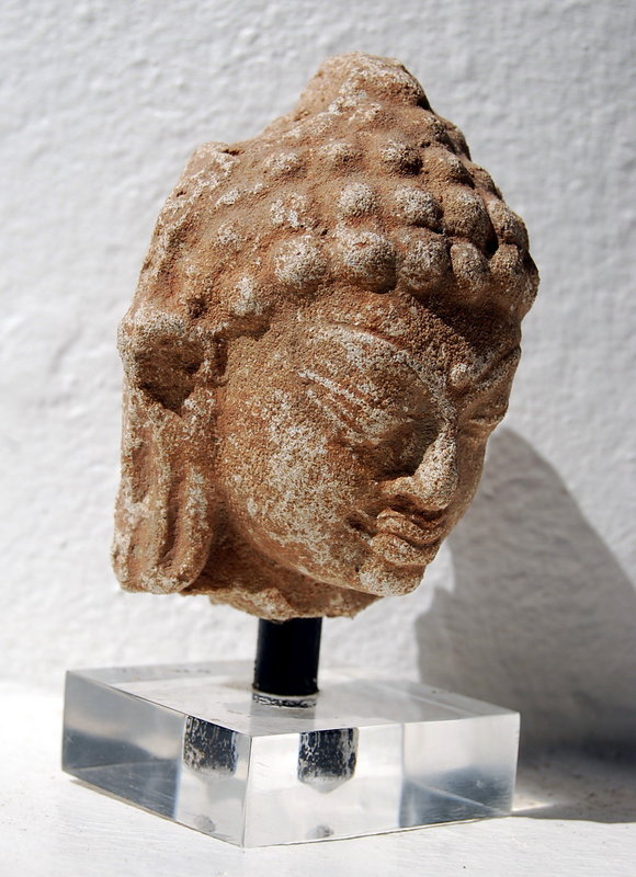 A HARIPUNCHAI Stucco Head of Buddha, 11th Century