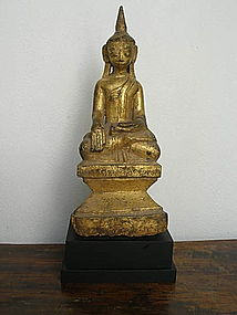 Gilt Wooden Buddha subduing Mara on base, 19th Century