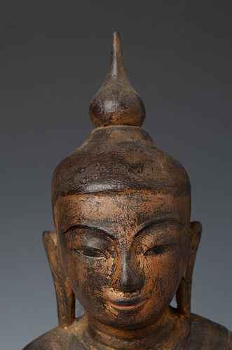 FINE GENUINE SHAN STATE SOLID WOODEN BUDDHA SUBDUING MARA, 18TH CENT.