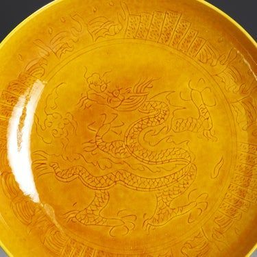 HONGZHI (HUNG-CHIH) DEEP YELLOW PLATE WITH DRAGON/RUYI CLOUDS