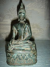 Bronze Buddha with rare base showing elephants, antique