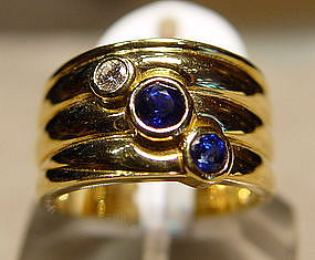 18K. Ring, 2 Ceylon Blue Sapphires and 1 Diamond