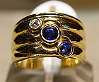 18K. Ring, 2 Ceylon Blue Sapphires and 1 Diamond