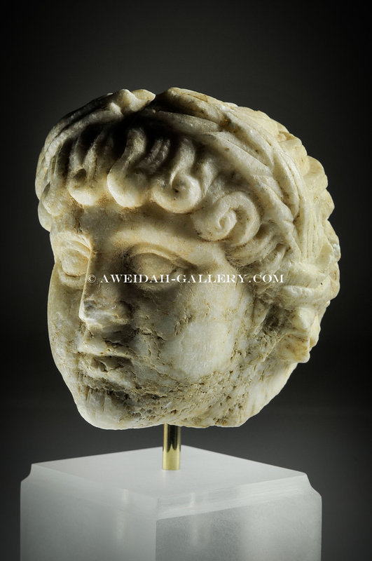 Roman marble head of a youth, 2nd Century AD