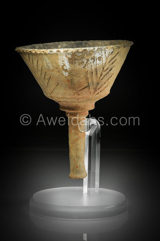A Talmudic period pottery torch, 6th Century AD