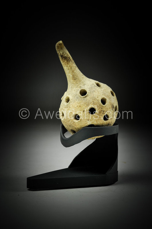 Ancient terra-cotta baby rattle, 2000 BC