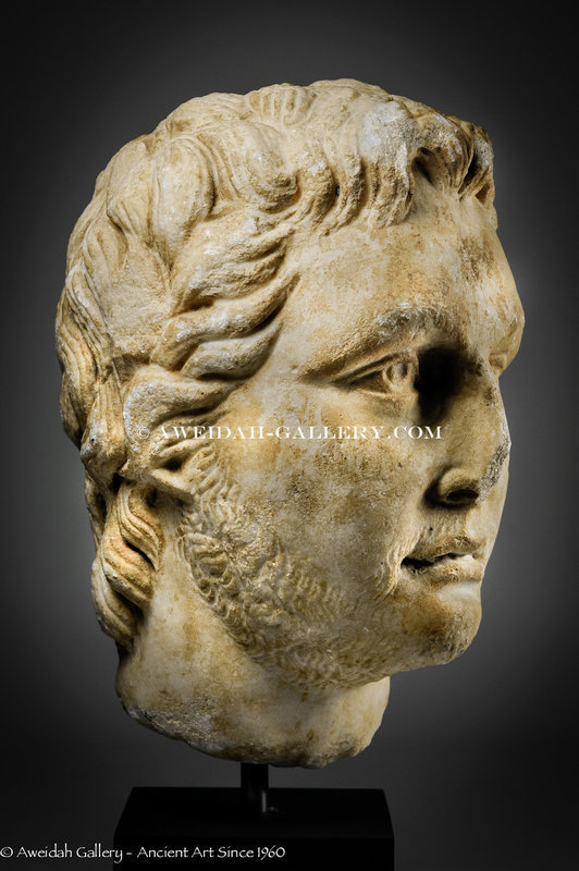 Roman marble portrait head of a youth, 2nd-3rd AD