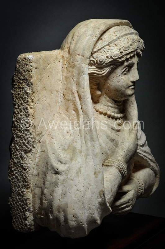 Roman limestone bust of a veiled female, 1st A.D