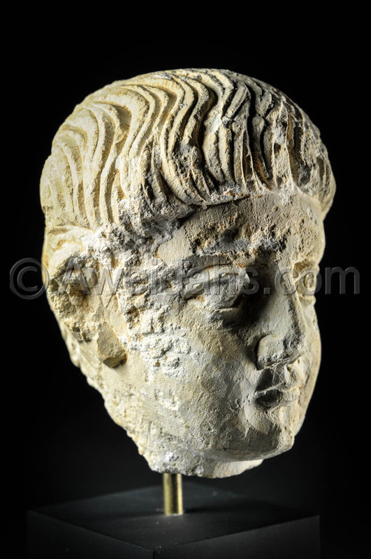 Limestone head of a youth, Roman Palmyra, 1st Century A.D