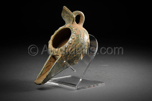 Islamic glazed pottery oil lamp, 12th Century AD