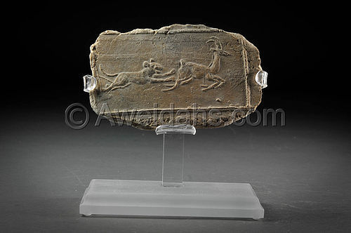Ancient Near-Eastern pottery plaque showing a hunting scene, 1800 BC