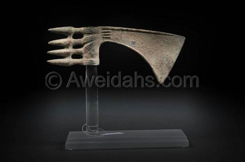 Persian decorated bronze spike-butted axe-head 1000 BC