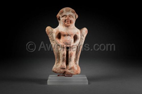 HOLLOW TERRACOTTA FIGURE OF A STANDING IDOL, 100 BC/AD