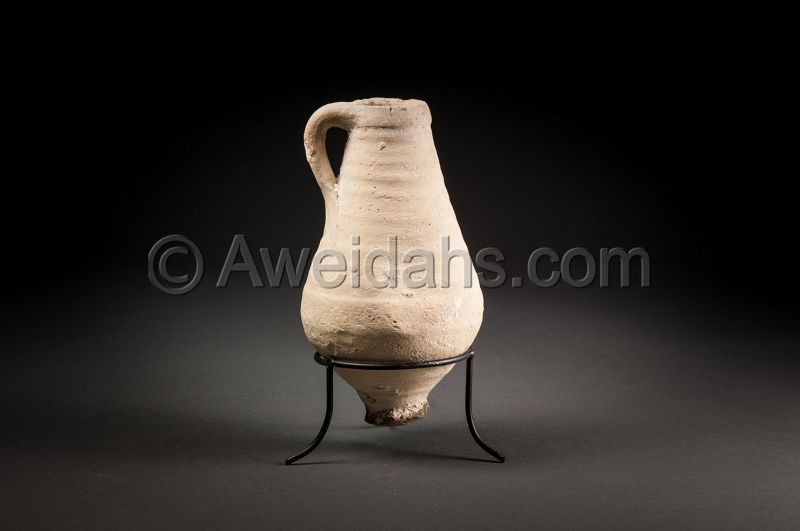 ANCIENT TERRACOTTA WINE MEASURING JUGLET, 330 BC
