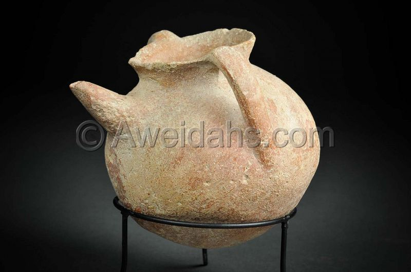 Canaanite Early Bronze age burnished pottery spouted jar, 3000 BC