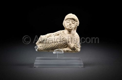 Ancient Parthian clay figure of a reclining man, 100 AD