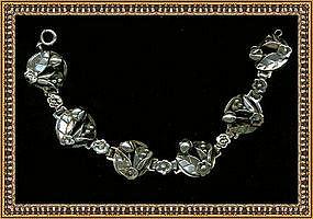 Vintage Late Arts & Crafts Sterling Bracelet 6 Foliate