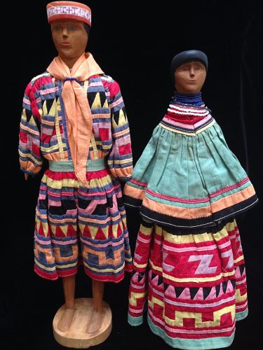 A Rare Pair of Matched Wood Seminole Dolls