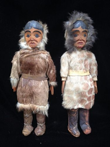 A Pair of Tlingit Wood Carved and Painted Dolls