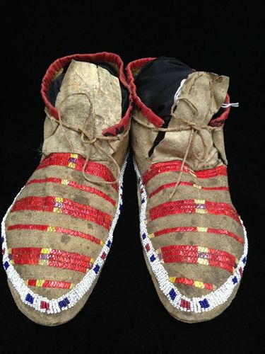 A Pair of Sioux Quilled and Beaded Hide Moccasins