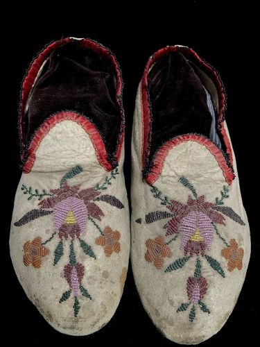 A Pair of  Beaded Santee Sioux Hide Moccasins