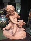 Fine Terracotta italian Sculpture of Putti or Cupid with Bird Signed