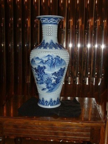 Antique Chinese blue/white reticulated tall vase in perfect condition.