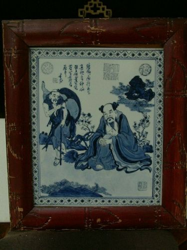 Antique Japanese plaque, blue and white, framed, in good condition.