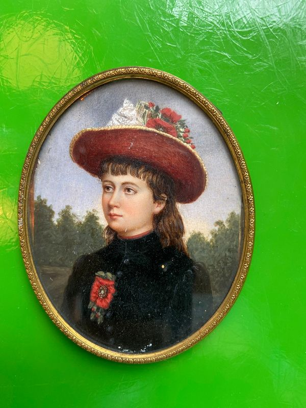 Antique framed oval miniature painting of an aristocrat woman.