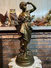 Antique large French bronze of a fisher woman by artist EUGENE LAURENT