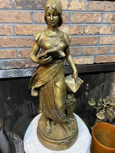 An original  large French bronze statue of a lady signed H. LEVASSEUR