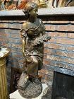 Antique large French bronze by Faure De Brousse of a lady harvesting.