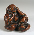 Big Chinese Burl Toggle, Seated Man, 18th/19th C.