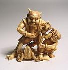 Japanese Ivory Okimono of Oni and Frogs