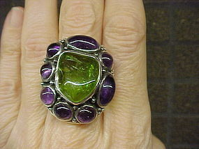 MODERNIST H. FRED SKAGGS PERIDOT AND AMETHYST RING