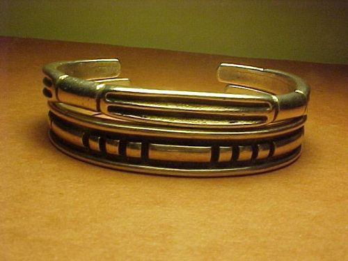 NAVAJO KENNETH BEGAY BRACELET PLUS WHITE HOGAN BRACELET