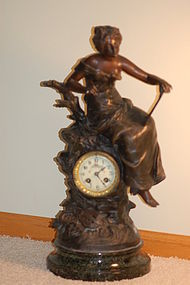 Marti French clock with L F Moreau signed statue C:1900