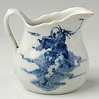 Chinese Export Blue and White Creamer with a Figure