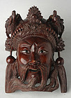 A Carved Wooden Chinese Hanging Mask