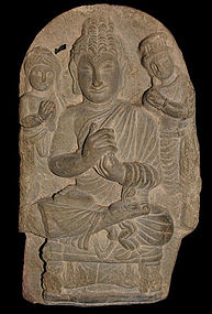 Gandhara carved schist stele of Buddha with attendants.