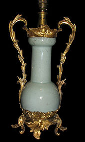 A Chinese ormolu mounted Guan-type vase.