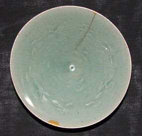 A Korean moulded celadon bowl. Koryo period.