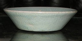 A Korean celadon shallow dish. Koryo period.