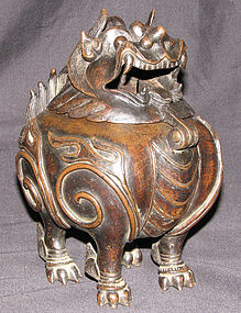 A Chinese bronze incense burner and cover.