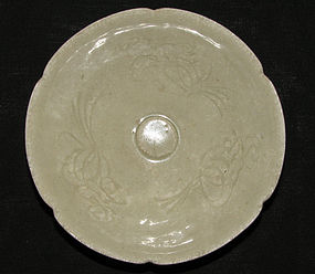 A Qingbai fluted shallow bowl with floral decoration.