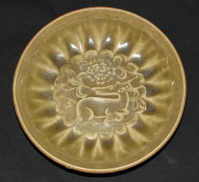 A molded celadon dish decorated with a deer.