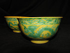 A fine pair of yellow ground green dragon bowls.