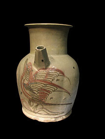 A Changsha ewer decorated with a bird in flight.