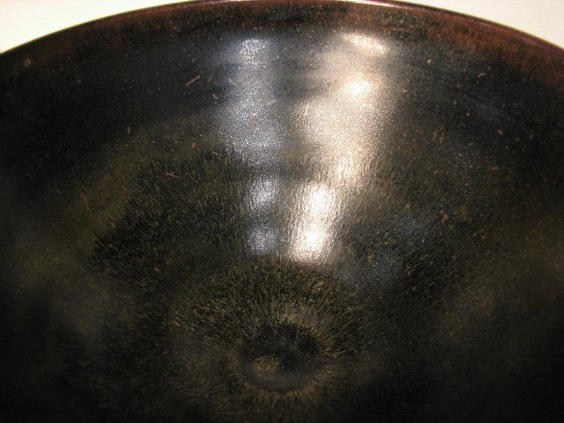 A Jian-type conical bowl with 'heir's fur' glaze.
