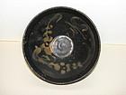 A Jizhou 'moon and prunus' tea bowl. 13th c.